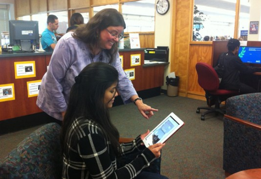 An Aurora University student uses the new eBook service at Phillips Library