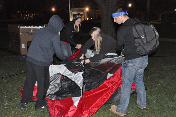 Aurora University students set up their tent during last year's Sleep Out on the Quad event.