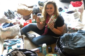 Chelsea Chandler displaying the items she donated to Hesed House