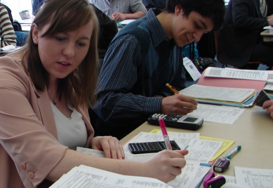 Aurora University students work on a client's tax returns during the first session of the 2013 Volunteer Income Tax Assistance program in Dunham Hall.