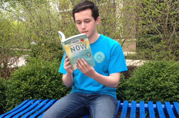 "Sophomore Hector Hernandez reads a Phillips Library recommended ""book of summer."""