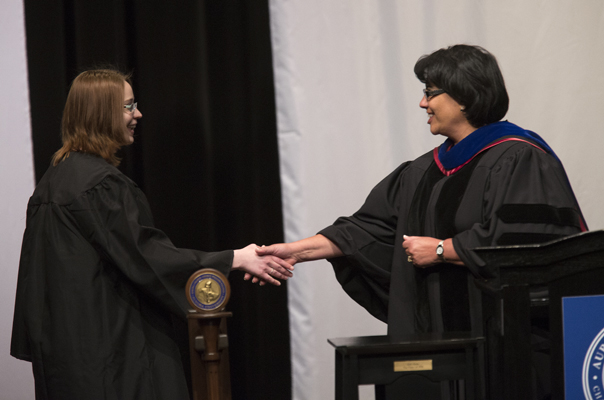 Carmella Moran, Dean of Undergraduate Studies presents Laura Russman, '14, (left) with the Ethel Tapper Humanities Award during Honors Convocation.