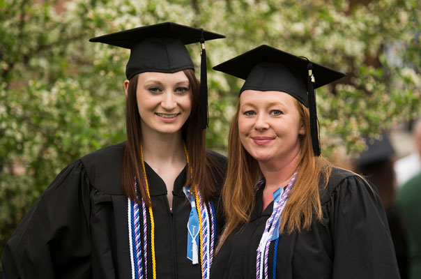 Ericka Fisher (left) with her mother Catina Fisher (right) at the 2015 Undergraduate Commencement Ceremony.