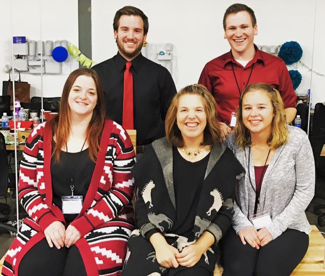 Students from AU's chapter of the American Marketing Associating won the first LaunchU digital marketing competition hosted by Naperville-based Launch Digital Marketing. Front row, L-R: Paige Fisher, LDM's Rachel Gelb, Kelly Hauge; back row, L-R: Bradley Kigyos, Cory Nordine.