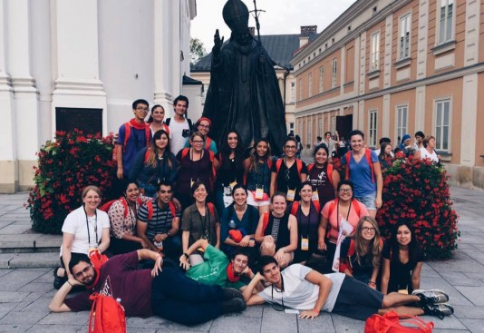 On the way to World Youth Day: Andy Misquez (first row, right) stops with fellow pilgrims in Wadowice, Poland, hometown of Pope John Paul II.