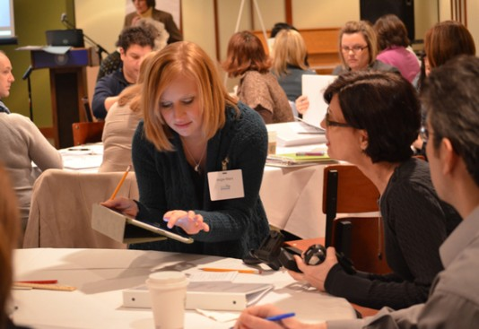 NGSS workshop participants work in groups to gain a better understanding of the practices and learn how to implement them in their own classrooms.